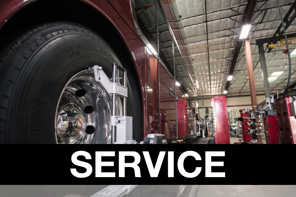 Service banner over photo of bus workshop